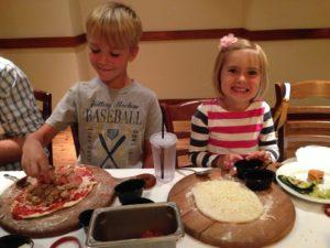 pinstripes making pizzas